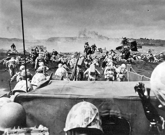 Marines landing on Iwo Jima beach